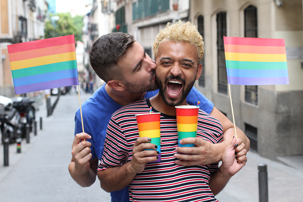 Cute gay couple partying outdoors